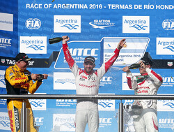 Tom Chilton and Jose Maria Lopez share the spoils in Argentina