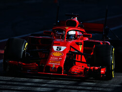 Vettel tops time sheets to begin second test