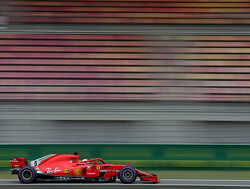 Vettel holds off Hamilton to take victory at Spa
