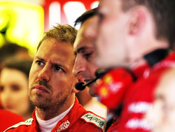 Vettel plays down Ferrari's gap over Mercedes