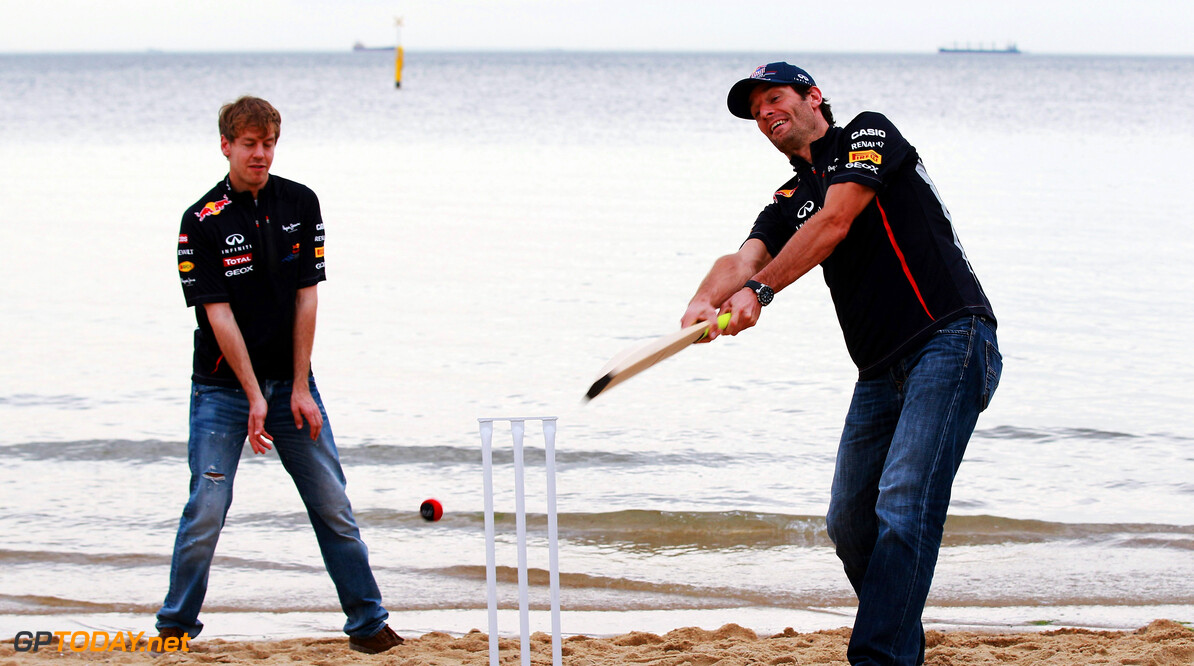141015460KR044_F1_Grand_Pri MELBOURNE, AUSTRALIA - MARCH 14:  (L-R) Sebastian Vettel of Germany and Red Bull Racing and Mark Webber of Australia and Red Bull Racing try their hand at beach cricket on St Kilda Beach during previews to the Australian Formula One Grand Prix on March 14, 2012 in Melbourne, Australia.  (Photo by Mark Thompson/Getty Images) *** Local Caption *** Mark Webber; Sebastian Vettel F1 Grand Prix Of Australia - Previews Mark Thompson Melbourne Australia  Formula One Racing