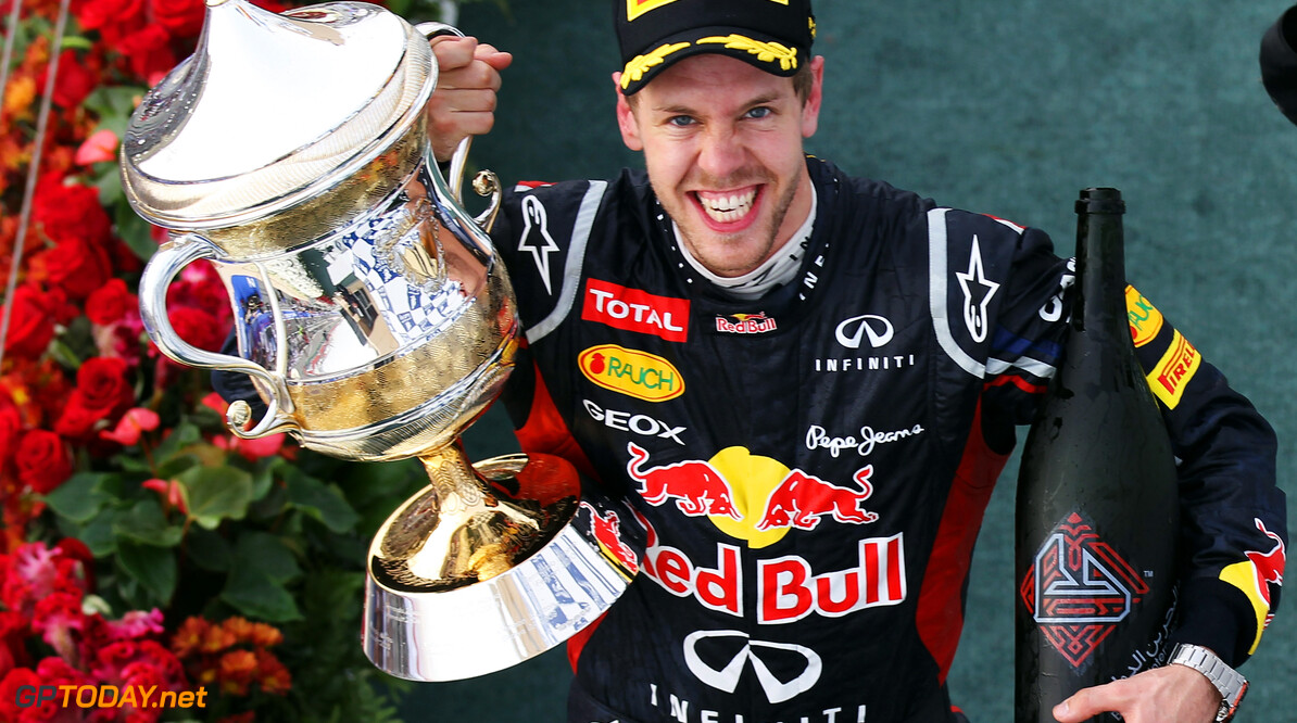 141015639KR065_Bahrain_F1_G SAKHIR, BAHRAIN - APRIL 22:  Sebastian Vettel of Germany and Red Bull Racing celebrates on the podium after winning the Bahrain Formula One Grand Prix at the Bahrain International Circuit on April 22, 2012 in Sakhir, Bahrain.  (Photo by Mark Thompson/Getty Images) *** Local Caption *** Sebastian Vettel Bahrain F1 Grand Prix - Race Mark Thompson Sakhir Bahrain  Formula One Racing F1