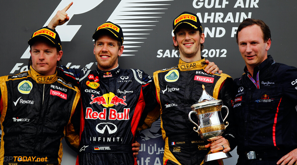 141015639KR119_Bahrain_F1_G SAKHIR, BAHRAIN - APRIL 22:  Race winner Sebastian Vettel (2nd left) of Germany and Red Bull Racing celebrates on the podium with second placed Kimi Raikkonen (left) of Finland and Lotus, third placed Romain Grosjean (2nd right) of France and Lotus and Red Bull Racing Team Principal Christian Horner (right) following the Bahrain Formula One Grand Prix at the Bahrain International Circuit on April 22, 2012 in Sakhir, Bahrain.  (Photo by Paul Gilham/Getty Images) *** Local Caption *** Sebastian Vettel; Kimi Raikkonen; Romain Grosjean; Christian Horner Bahrain F1 Grand Prix - Race Paul Gilham Sakhir Bahrain  Formula One Racing F1