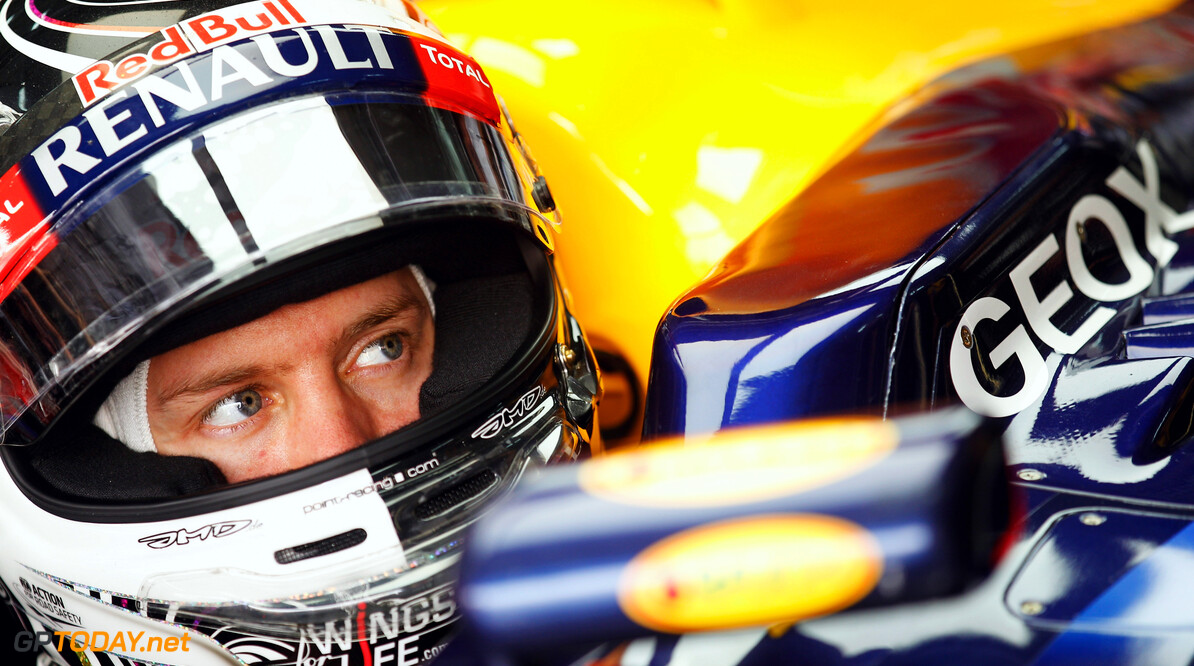 141015632KR021_Bahrain_F1_G SAKHIR, BAHRAIN - APRIL 20:  Sebastian Vettel of Germany and Red Bull Racing prepares to drive during practice for the Bahrain Formula One Grand Prix at the Bahrain International Circuit on April 20, 2012 in Sakhir, Bahrain.  (Photo by Paul Gilham/Getty Images) *** Local Caption *** Sebastian Vettel Bahrain F1 Grand Prix - Practice Paul Gilham Sakhir Bahrain  Formula One Racing F1