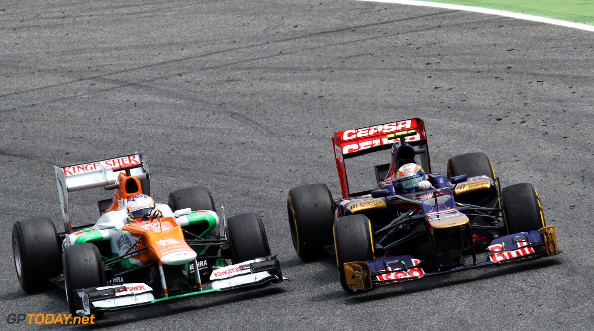 Formula One World Championship (L to R): Paul di Resta (GBR) Sahara Force India VJM05 with Jean-Eric Vergne (FRA) Scuderia Toro Rosso STR7.