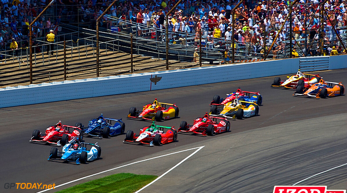 "2012 IndyCar Indy 500 Race Priority 27 May, 2012, Indianapolis, Indiana, USA.After a restart, Simon Pagenaud (#77) leads Scott Dixon (#9), Alex Tagliani (#98), Michel Jourdain, Jr. (#30), Dario Franchitti (#50), Sebastian Saavedra (#17), Ryan Hunter-Reay (#28), Graham Rahal (#38), Charlie Kimball (#83) and Helio Castroneves (#3) into turn one..(c)2012, F. Peirce Williams.LAT Photo USA.IMAGE COURTESY OF INDYCAR FOR EDITORIAL USAGE ONLY.  MANDATORY CREDIT: ""INDYCAR/LAT USA""      Simon Pagenaud Scott Dixon Alex Tagliani Michel Jourdain Jr Dario Franchitti Sebastian Saavedra Ryan Hunter-Reay Graham Rahal Charlie Kimball Helio Castroneves 2012 IndyCar Indy 500 Race"