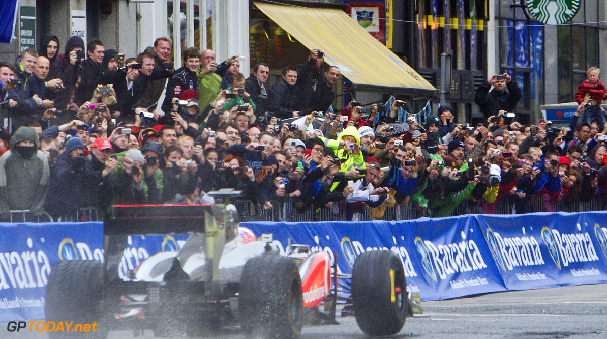 Jenson Button - Bavaria City Race Dublin NO REPRO FEE 03/06/2012 Bavaria City Racing Dublin today announced that for the first time ever, one of the leading F1 teams in the world will take to the streets of Dublin. Thanks to Vodafone Ireland, the Vodafone McLaren-Mercedes F1 team has been signed up for the street racing exhibition in Dublin city centre on Sunday 3rd June. Jenson Button will race his F1 Vodafone McLaren-Mercedes along the Dublin city track which starts at the Convention Centre Dublin, continues along Customs House Quay before crossing Butt Bridge, chicane's at D'Olier Street, zips past College Green and the Central Bank on Dame Street before reaching the chequered flag on O'Connell Bridge. Bavaria City Racing Dublin is a free public event and over 150,000 people are expected to line the streets of Dublin to enjoy the best the world of motorsport has to offer. For those who want to get closer to the action there are three ticketed premium performance zones on the track at Customs House Quay, O'