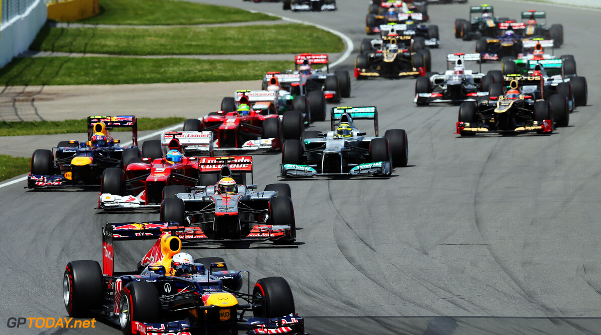 141017537KR014_Canadian_F1_ MONTREAL, CANADA - JUNE 10:  Sebastian Vettel of Germany and Red Bull Racing leads the field into the first corner at the start of the Canadian Formula One Grand Prix at the Circuit Gilles Villeneuve on June 10, 2012 in Montreal, Canada.  (Photo by Mark Thompson/Getty Images) *** Local Caption *** Sebastian Vettel Canadian F1 Grand Prix - Race Mark Thompson Montreal Canada  Formula One Racing F1
