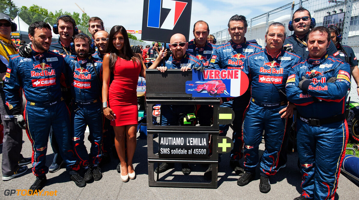 141017537KR063_Canadian_F1_ MONTREAL, CANADA - JUNE 10:  Scuderia Toro Rosso team show their support for the victims of the recent earthquakes in Italy before Canadian Formula One Grand Prix at the Circuit Gilles Villeneuve on June 10, 2012 in Montreal, Canada.  (Photo by Peter Fox/Getty Images) Canadian F1 Grand Prix - Race Peter Fox Montreal Canada  Formula One Racing F1