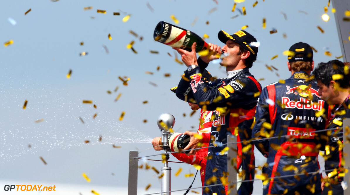 141017654KR00048_F1_Grand_P NORTHAMPTON, ENGLAND - JULY 08:  Mark Webber of Australia and Red Bull Racing celebrates on the podium after winning the British Grand Prix at Silverstone Circuit on July 8, 2012 in Northampton, England.  (Photo by Clive Mason/Getty Images) *** Local Caption *** Mark Webber F1 Grand Prix of Great Britain - Race Clive Mason Northampton United Kingdom  Formula One Racing