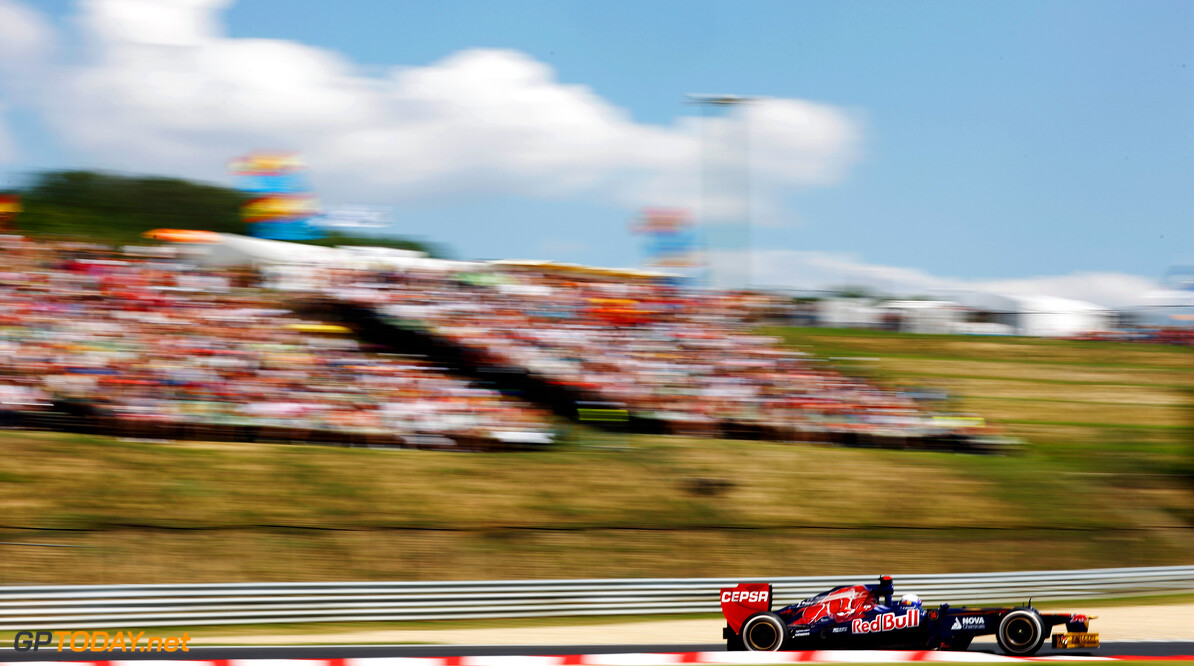 141017825KR00129_F1_Grand_P BUDAPEST, HUNGARY - JULY 28:  Daniel Ricciardo of Australia and Scuderia Toro Rosso drives during qualifying for the Hungarian Formula One Grand Prix at the Hungaroring on July 28, 2012 in Budapest, Hungary.  (Photo by Drew Gibson/Getty Images) *** Local Caption *** Daniel Ricciardo F1 Grand Prix of Hungary - Qualifying Drew Gibson Budapest Hungary  Formula One Racing