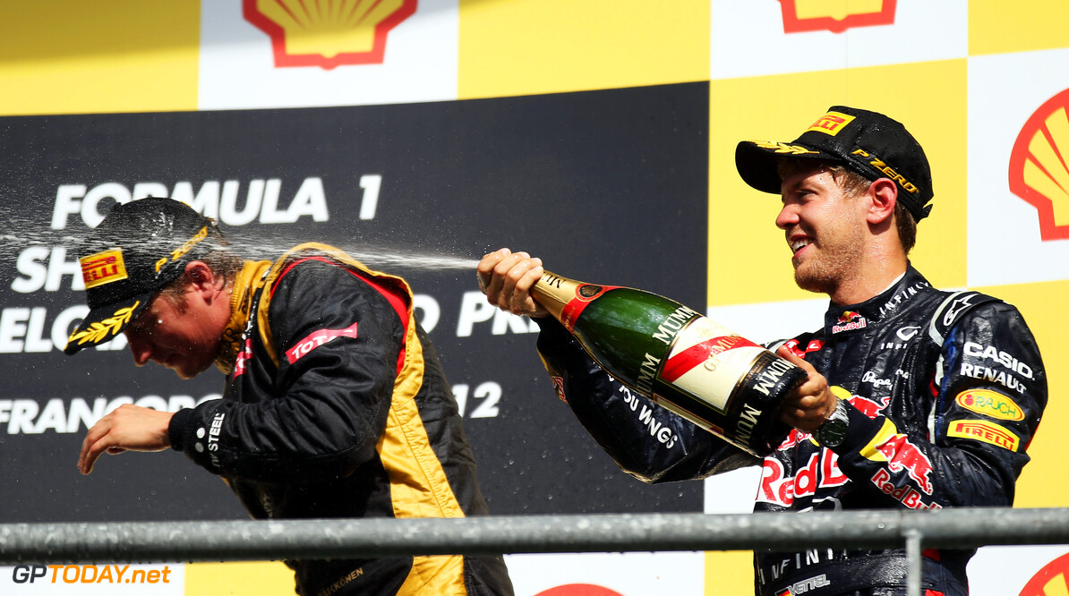 141017907KR00149_F1_Grand_P SPA, BELGIUM - SEPTEMBER 02:  Second placed Sebastian Vettel (R) of Germany and Red Bull Racing and third placed Kimi Raikkonen (L) of Finland and Lotus celebrates on the podium following the the Belgian Grand Prix at the Circuit of Spa Francorchamps on September 2, 2012 in Spa Francorchamps, Belgium.  (Photo by Mark Thompson/Getty Images) *** Local Caption *** Sebastian Vettel; Kimi Raikkonen F1 Grand Prix of Belgium Mark Thompson Spa Belgium  Formula One Racing