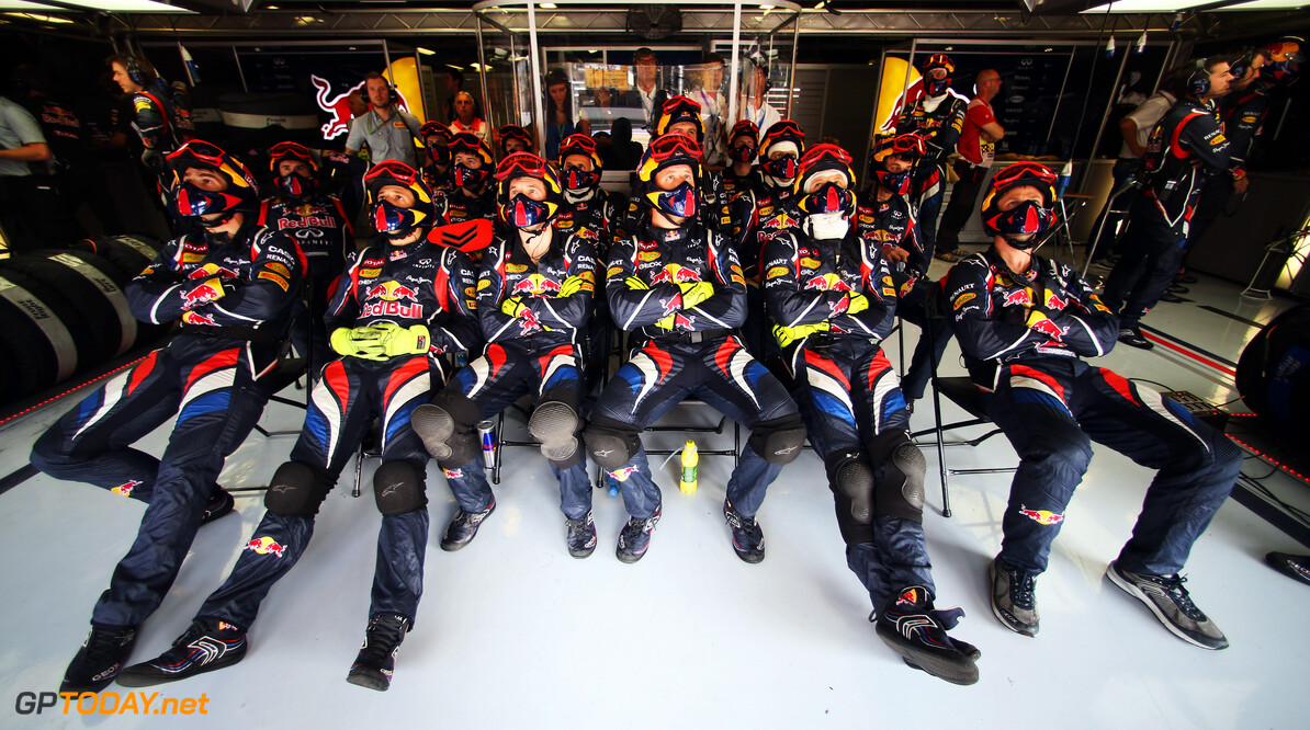 141017992KR00215_F1_Grand_P MONZA, ITALY - SEPTEMBER 09:  Red Bull Racing mechanics are seen in their team garage during the Italian Formula One Grand Prix at the Autodromo Nazionale di Monza on September 9, 2012 in Monza, Italy.  (Photo by Mark Thompson/Getty Images) F1 Grand Prix of Italy Mark Thompson Monza Italy  Formula One Racing