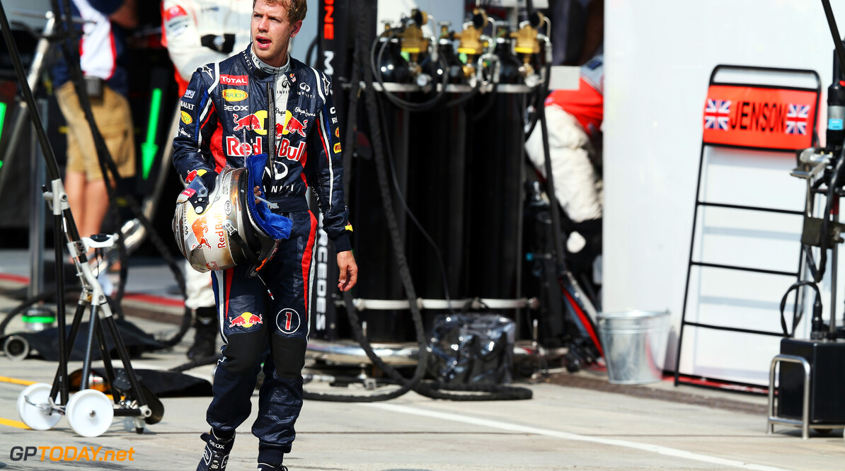 141017992KR00211_F1_Grand_P MONZA, ITALY - SEPTEMBER 09:  Sebastian Vettel of Germany and Red Bull Racing walks back to his team garage after retiring early during the Italian Formula One Grand Prix at the Autodromo Nazionale di Monza on September 9, 2012 in Monza, Italy.  (Photo by Mark Thompson/Getty Images) *** Local Caption *** Sebastian Vettel F1 Grand Prix of Italy Mark Thompson Monza Italy  Formula One Racing
