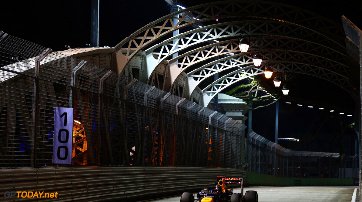 141020438KR00080_F1_Grand_P SINGAPORE - SEPTEMBER 21:  Sebastian Vettel of Germany and Red Bull Racing drives over the Anderson Bridge during practice for the Singapore Formula One Grand Prix at the Marina Bay Street Circuit on September 21, 2012 in Singapore, Singapore.  (Photo by Paul Gilham/Getty Images) *** Local Caption *** Sebastian Vettel F1 Grand Prix of Singapore - Practice Paul Gilham Singapore Singapore  Formula One Racing