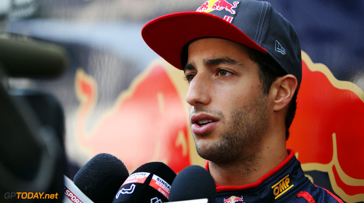 141020429KR00049_F1_Grand_P SINGAPORE - SEPTEMBER 20:  Daniel Ricciardo of Australia and Scuderia Toro Rosso is interviewed by the media in the paddock during previews for the Singapore Formula One Grand Prix at the Marina Bay Street Circuit on September 20, 2012 in Singapore, Singapore.  (Photo by Ker Robertson/Getty Images) *** Local Caption *** Daniel Ricciardo F1 Grand Prix of Singapore - Previews Ker Robertson Singapore Singapore  Formula One Racing