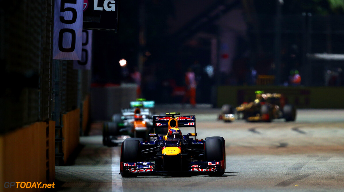 141020443KR00244_F1_Grand_P SINGAPORE - SEPTEMBER 23:  Mark Webber of Australia and Red Bull Racing drives during the Singapore Formula One Grand Prix at the Marina Bay Street Circuit on September 23, 2012 in Singapore, Singapore.  (Photo by Clive Mason/Getty Images) *** Local Caption *** Mark Webber F1 Grand Prix of Singapore Clive Mason Singapore Singapore  Formula One Racing