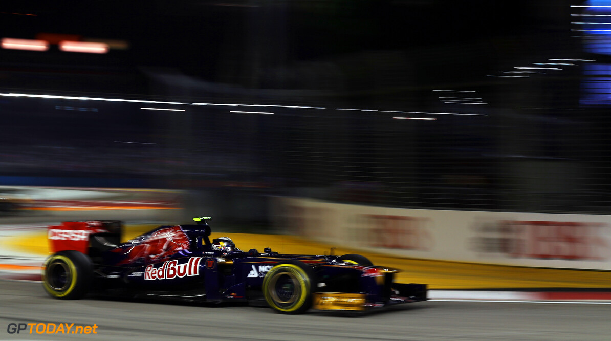141020443KR00191_F1_Grand_P SINGAPORE - SEPTEMBER 23:  Jean-Eric Vergne of France and Scuderia Toro Rosso drives during the Singapore Formula One Grand Prix at the Marina Bay Street Circuit on September 23, 2012 in Singapore, Singapore.  (Photo by Mark Thompson/Getty Images) *** Local Caption *** Jean-Eric Vergne F1 Grand Prix of Singapore Mark Thompson Singapore Singapore  Formula One Racing