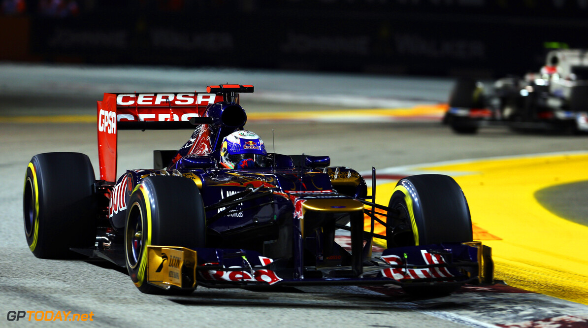 141020443KR00189_F1_Grand_P SINGAPORE - SEPTEMBER 23:  Daniel Ricciardo of Australia and Scuderia Toro Rosso drives during the Singapore Formula One Grand Prix at the Marina Bay Street Circuit on September 23, 2012 in Singapore, Singapore.  (Photo by Clive Mason/Getty Images) *** Local Caption *** Daniel Ricciardo F1 Grand Prix of Singapore Clive Mason Singapore Singapore  Formula One Racing