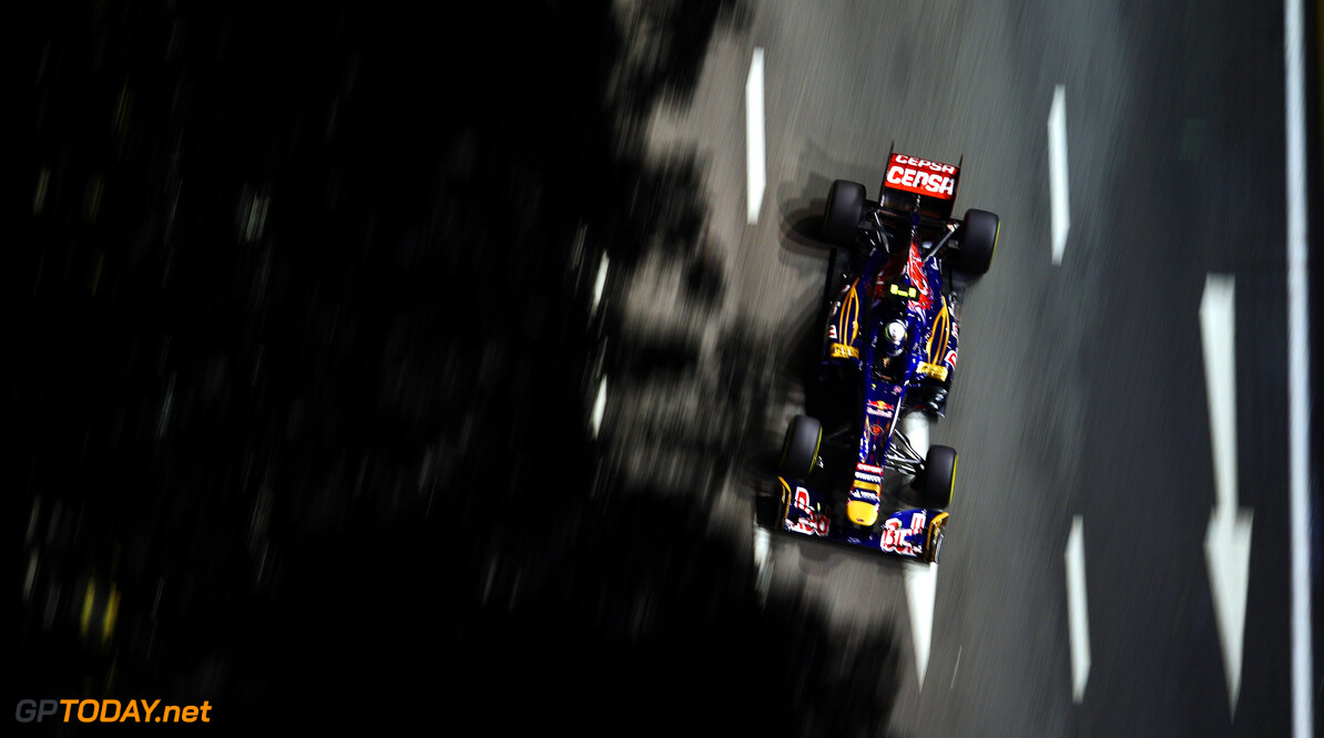 141020438KR00053_F1_Grand_P SINGAPORE - SEPTEMBER 21:  Jean-Eric Vergne of France and Scuderia Toro Rosso drives during practice for the Singapore Formula One Grand Prix at the Marina Bay Street Circuit on September 21, 2012 in Singapore, Singapore.  (Photo by Clive Mason/Getty Images) *** Local Caption *** Jean-Eric Vergne F1 Grand Prix of Singapore - Practice Clive Mason Singapore Singapore  Formula One Racing