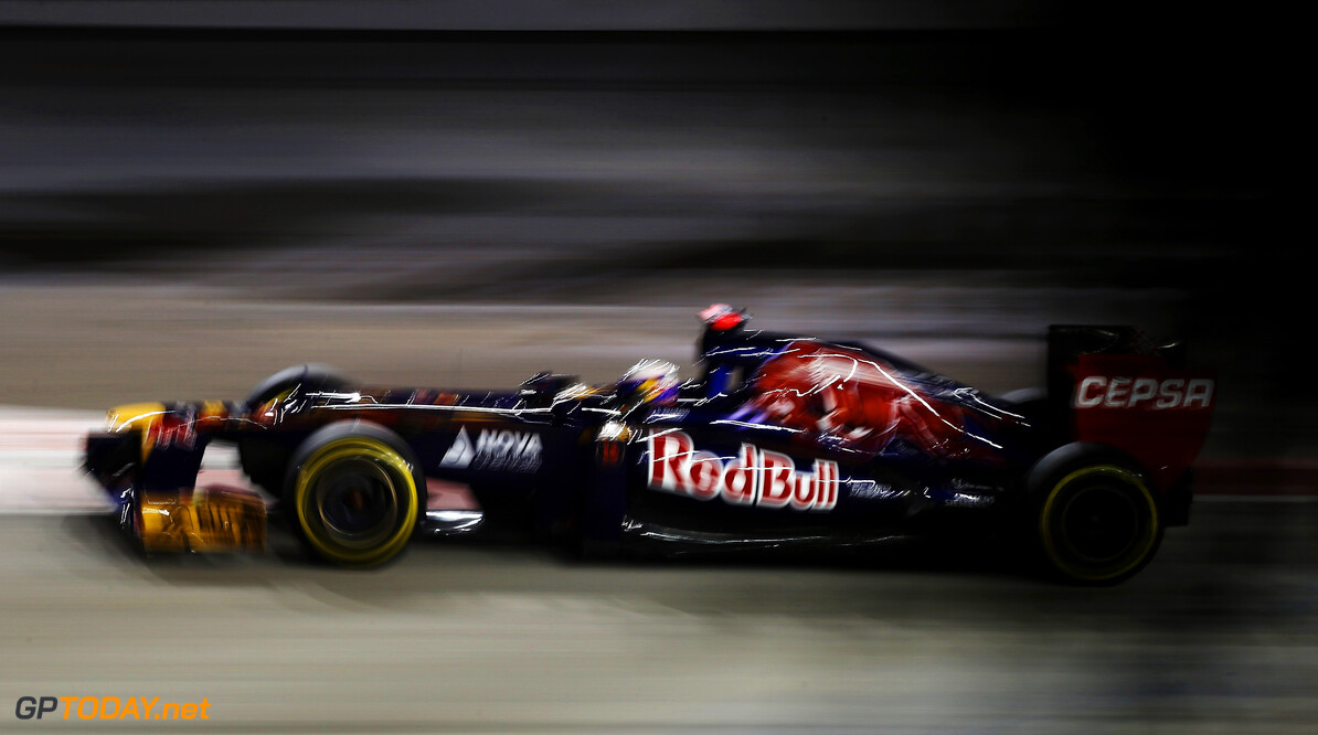 141020438KR00054_F1_Grand_P SINGAPORE - SEPTEMBER 21:  Daniel Ricciardo of Australia and Scuderia Toro Rosso drives during practice for the Singapore Formula One Grand Prix at the Marina Bay Street Circuit on September 21, 2012 in Singapore, Singapore.  (Photo by Mark Thompson/Getty Images) *** Local Caption *** Daniel Ricciardo F1 Grand Prix of Singapore - Practice Mark Thompson Singapore Singapore  Formula One Racing