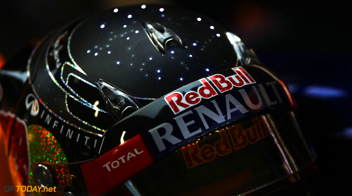 141020438KR00023_F1_Grand_P SINGAPORE - SEPTEMBER 21:  Sebastian Vettel of Germany and Red Bull Racing prepares to drive in special newly designed illuminating helmet during practice for the Singapore Formula One Grand Prix at the Marina Bay Street Circuit on September 21, 2012 in Singapore, Singapore.  (Photo by Paul Gilham/Getty Images) *** Local Caption *** Sebastian Vettel F1 Grand Prix of Singapore - Practice Paul Gilham Singapore Singapore  Formula One Racing