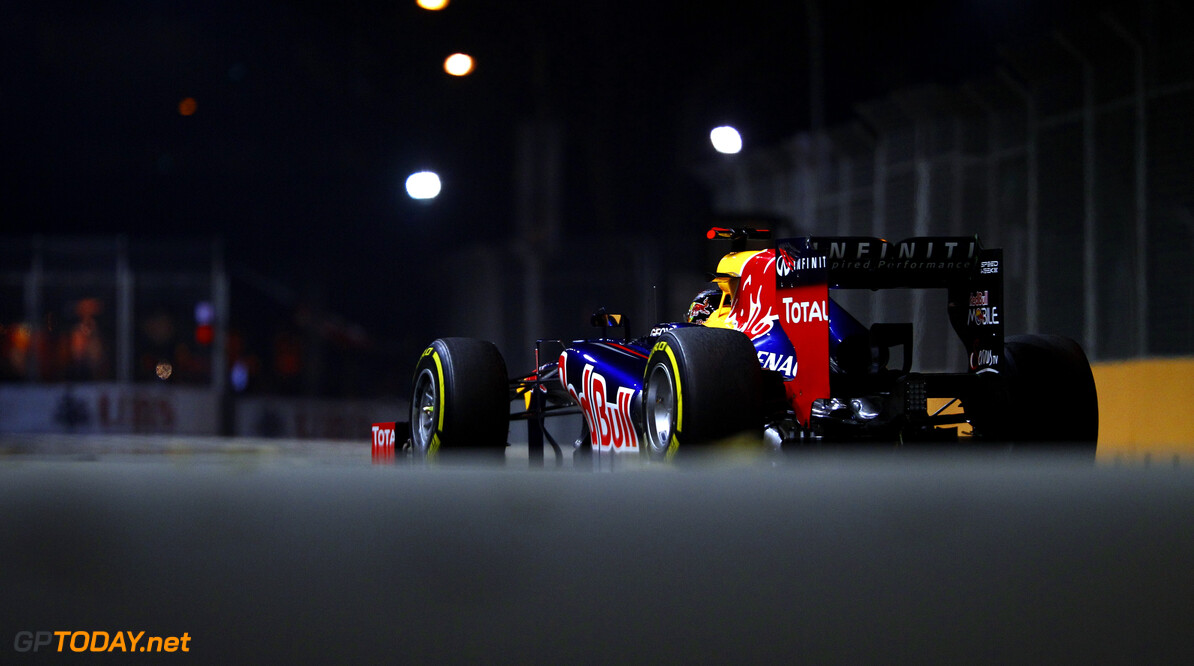 Sebastian Vettel of Germany and Red Bull Racing drives during the Formula One Grand Prix of Singapore at Marina Bay Street Circuit on September 23, 2012 in Singapore. F1 Grand Prix of Singapore Vladimir Rys Singapore Singapore  Formula One Racing