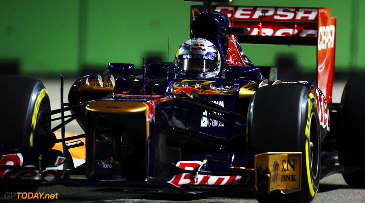 141020438KR00221_F1_Grand_P SINGAPORE - SEPTEMBER 21:  Jean-Eric Vergne of France and Scuderia Toro Rosso drives during practice for the Singapore Formula One Grand Prix at the Marina Bay Street Circuit on September 21, 2012 in Singapore, Singapore.  (Photo by Mark Thompson/Getty Images) *** Local Caption *** Jean-Eric Vergne F1 Grand Prix of Singapore - Practice Mark Thompson Singapore Singapore  Formula One Racing