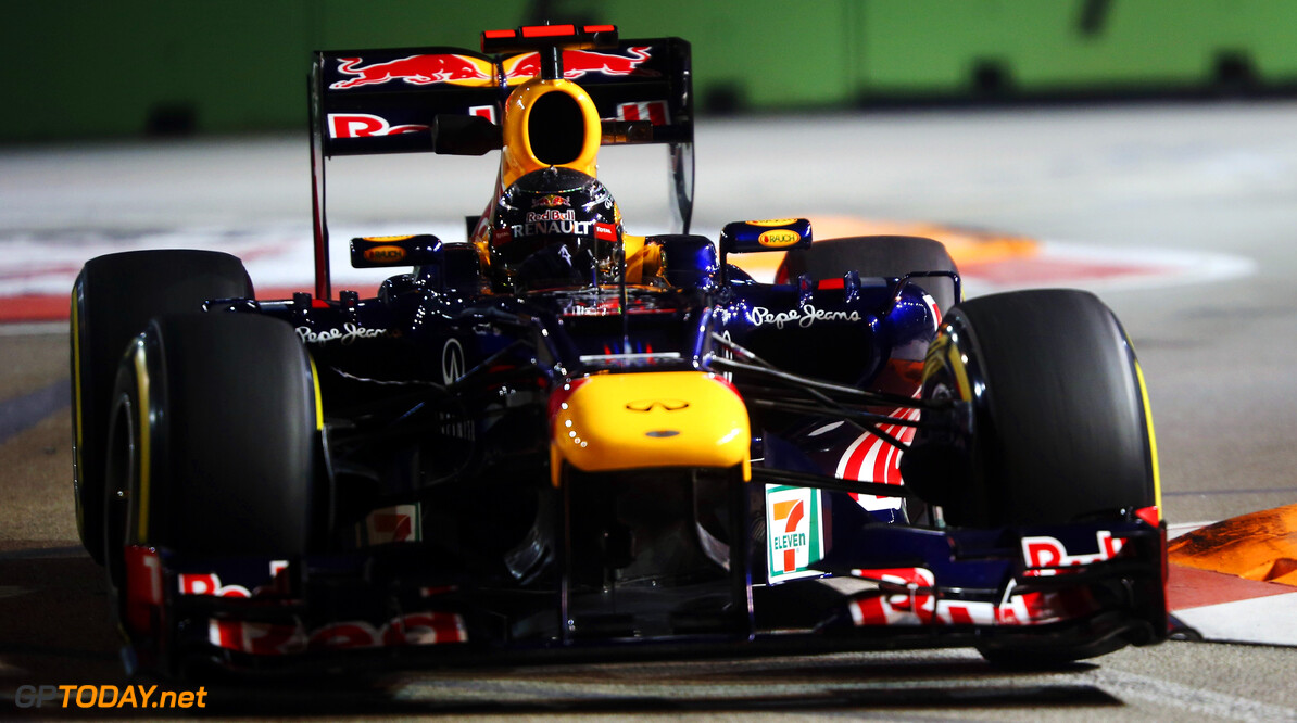 141020438KR00187_F1_Grand_P SINGAPORE - SEPTEMBER 21:  Sebastian Vettel of Germany and Red Bull Racing drives during practice for the Singapore Formula One Grand Prix at the Marina Bay Street Circuit on September 21, 2012 in Singapore, Singapore.  (Photo by Mark Thompson/Getty Images) *** Local Caption *** Sebastian Vettel F1 Grand Prix of Singapore - Practice Mark Thompson Singapore Singapore  Formula One Racing