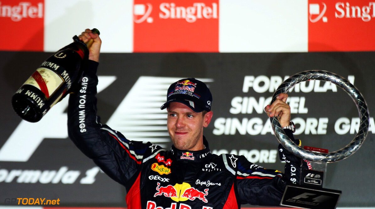 141020443KR00105_F1_Grand_P SINGAPORE - SEPTEMBER 23:  Sebastian Vettel of Germany and Red Bull Racing celebrates on the podium after winning the Singapore Formula One Grand Prix at the Marina Bay Street Circuit on September 23, 2012 in Singapore, Singapore.  (Photo by Mark Thompson/Getty Images) *** Local Caption *** Sebastian Vettel F1 Grand Prix of Singapore Mark Thompson Singapore Singapore  Formula One Racing