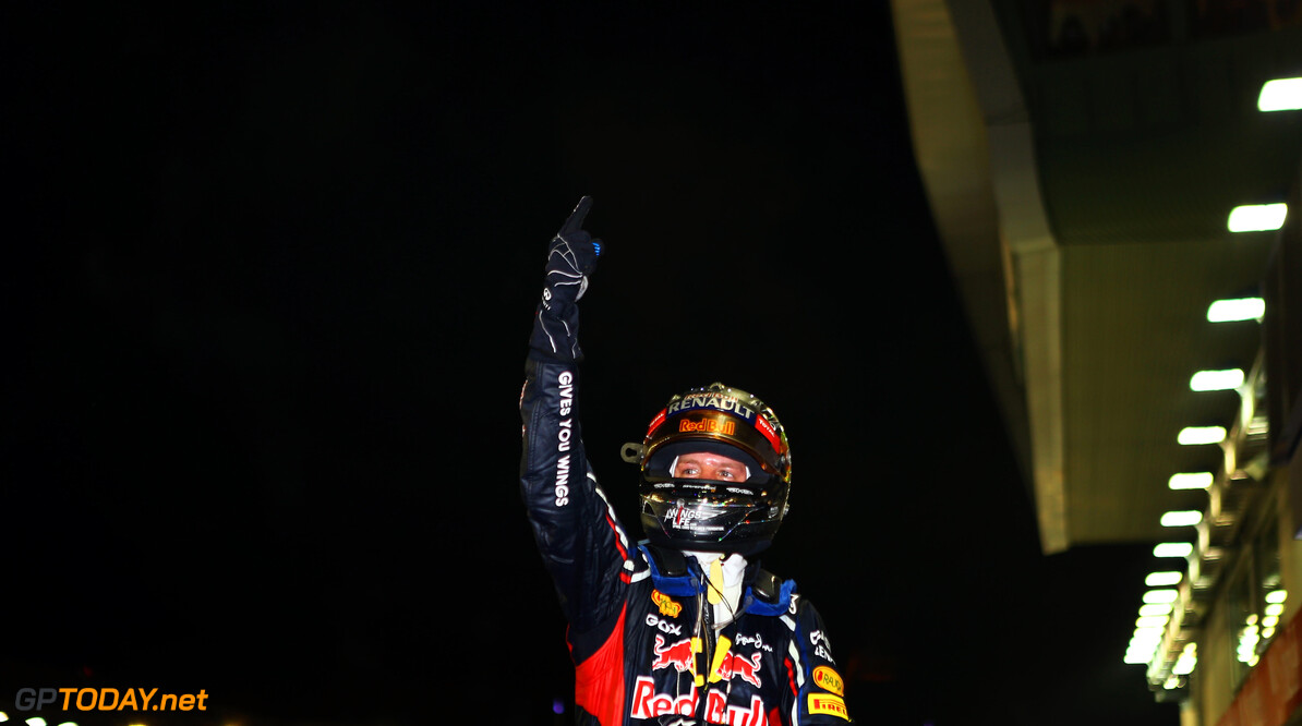141020443KR00077_F1_Grand_P SINGAPORE - SEPTEMBER 23:  Sebastian Vettel of Germany and Red Bull Racing celebrates in parc ferme after winning the Singapore Formula One Grand Prix at the Marina Bay Street Circuit on September 23, 2012 in Singapore, Singapore.  (Photo by Paul Gilham/Getty Images) *** Local Caption *** Sebastian Vettel F1 Grand Prix of Singapore Paul Gilham Singapore Singapore  Formula One Racing