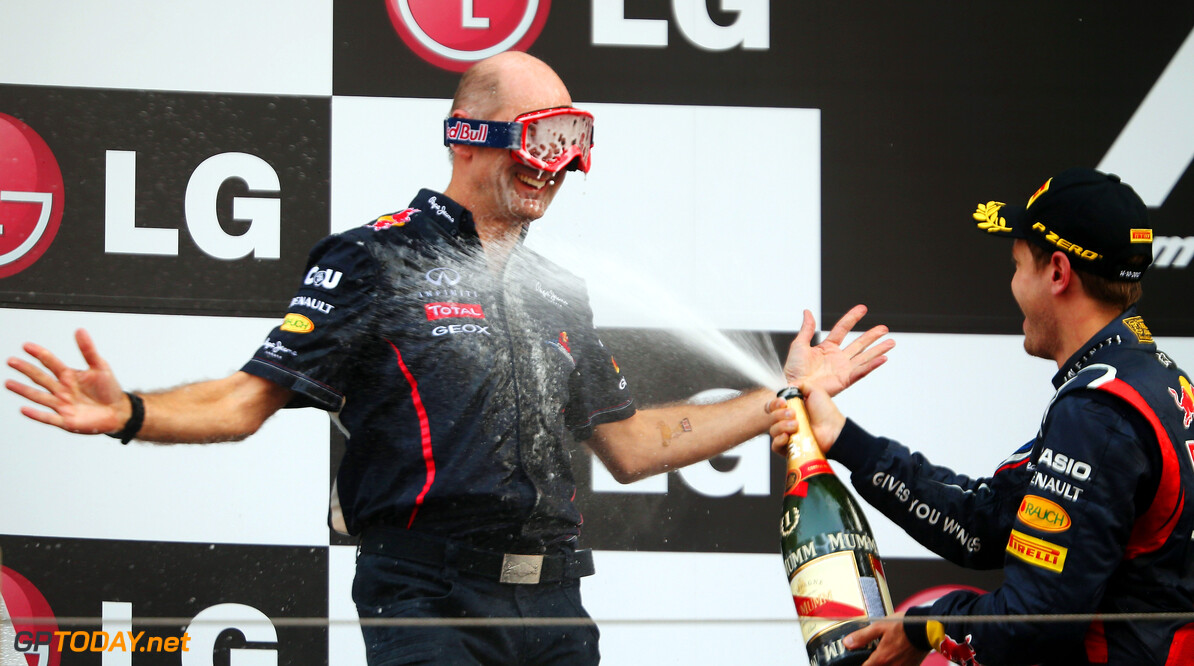 141020561KR00117_F1_Grand_P YEONGAM-GUN, SOUTH KOREA - OCTOBER 14:  Red Bull Racing Chief Technical Officer Adrian Newey wears mechanics goggles to protect his eyes as race winner Sebastian Vettel of Germany and Red Bull Racing sprays champagne on the podium following the Korean Formula One Grand Prix at the Korea International Circuit on October 14, 2012 in Yeongam-gun, South Korea.  (Photo by Mark Thompson/Getty Images) *** Local Caption *** Sebastian Vettel; Adrian Newey F1 Grand Prix of Korea Mark Thompson Yeongam-gun South Korea  Formula One Racing