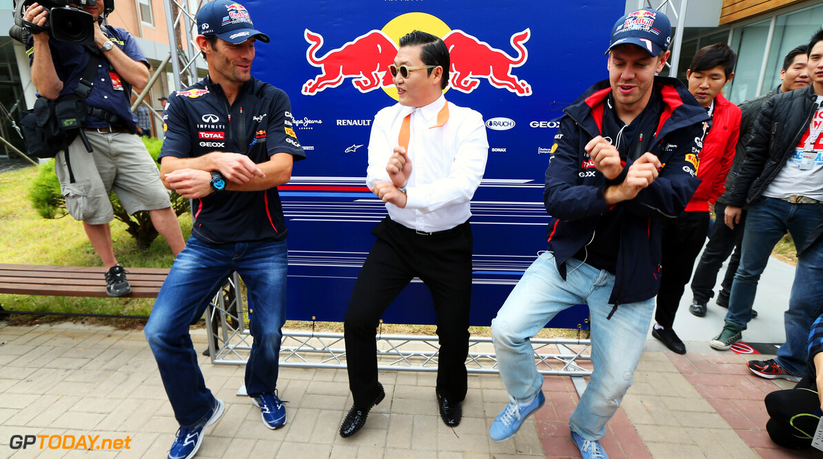 141020561KR00018_F1_Grand_P YEONGAM-GUN, SOUTH KOREA - OCTOBER 14:  Korean rapper Psy (C) teaches Red Bull Racing drivers Mark Webber (L) and Sebastian Vettel (R) the Gangnam Style dance in the paddock before the Korean Formula One Grand Prix at the Korea International Circuit on October 14, 2012 in Yeongam-gun, South Korea.  (Photo by Mark Thompson/Getty Images) *** Local Caption *** Psy; Sebastian Vettel; Mark Webber F1 Grand Prix of Korea Mark Thompson Yeongam-gun South Korea  Formula One Racing