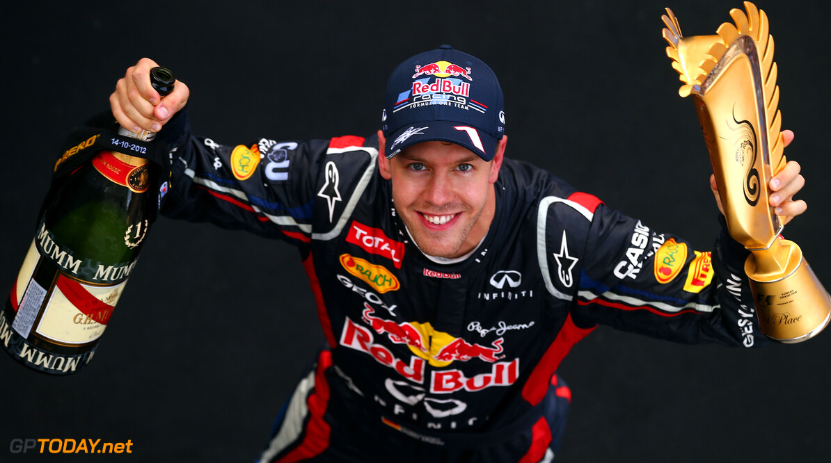 141020561KR00075_F1_Grand_P YEONGAM-GUN, SOUTH KOREA - OCTOBER 14:  Sebastian Vettel of Germany and Red Bull Racing celebrates on the podium after winning the Korean Formula One Grand Prix at the Korea International Circuit on October 14, 2012 in Yeongam-gun, South Korea.  (Photo by Clive Rose/Getty Images) *** Local Caption *** Sebastian Vettel F1 Grand Prix of Korea Clive Rose Yeongam-gun South Korea  Formula One Racing