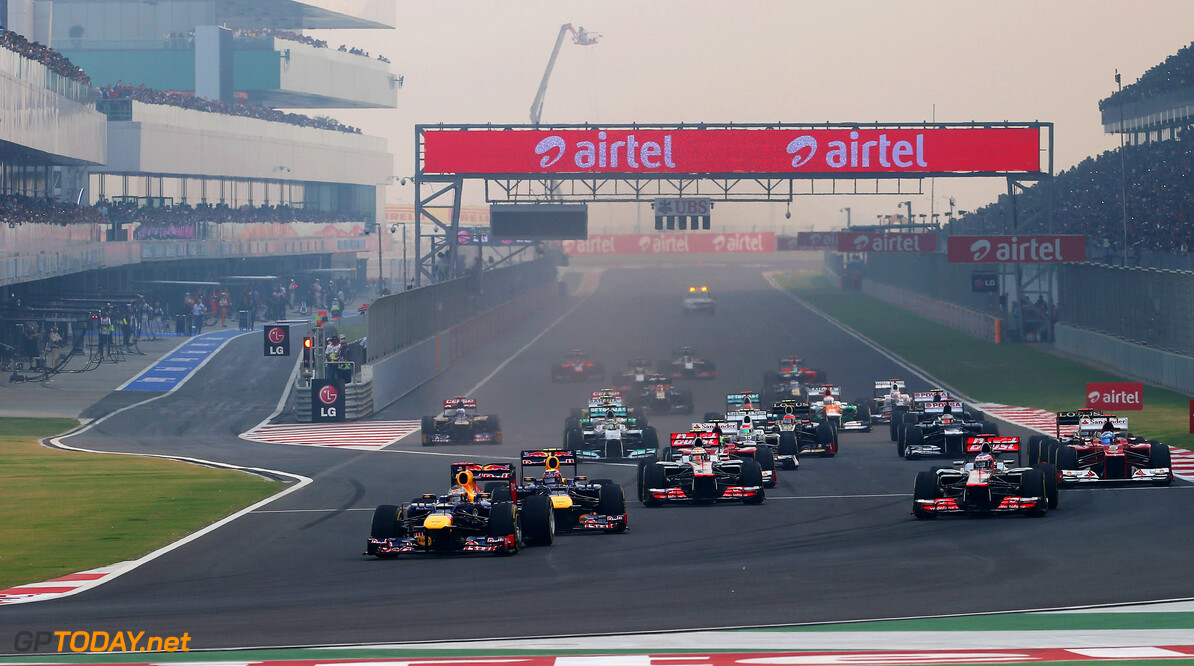 141020671KR00042_F1_Grand_P NOIDA, INDIA - OCTOBER 28:  Sebastian Vettel of Germany and Red Bull Racing leads the field into the first corner at the start of the Indian Formula One Grand Prix at Buddh International Circuit on October 28, 2012 in Noida, India.  (Photo by Mark Thompson/Getty Images) *** Local Caption *** Sebastian Vettel F1 Grand Prix Of India Mark Thompson Noida India  Formula One Racing
