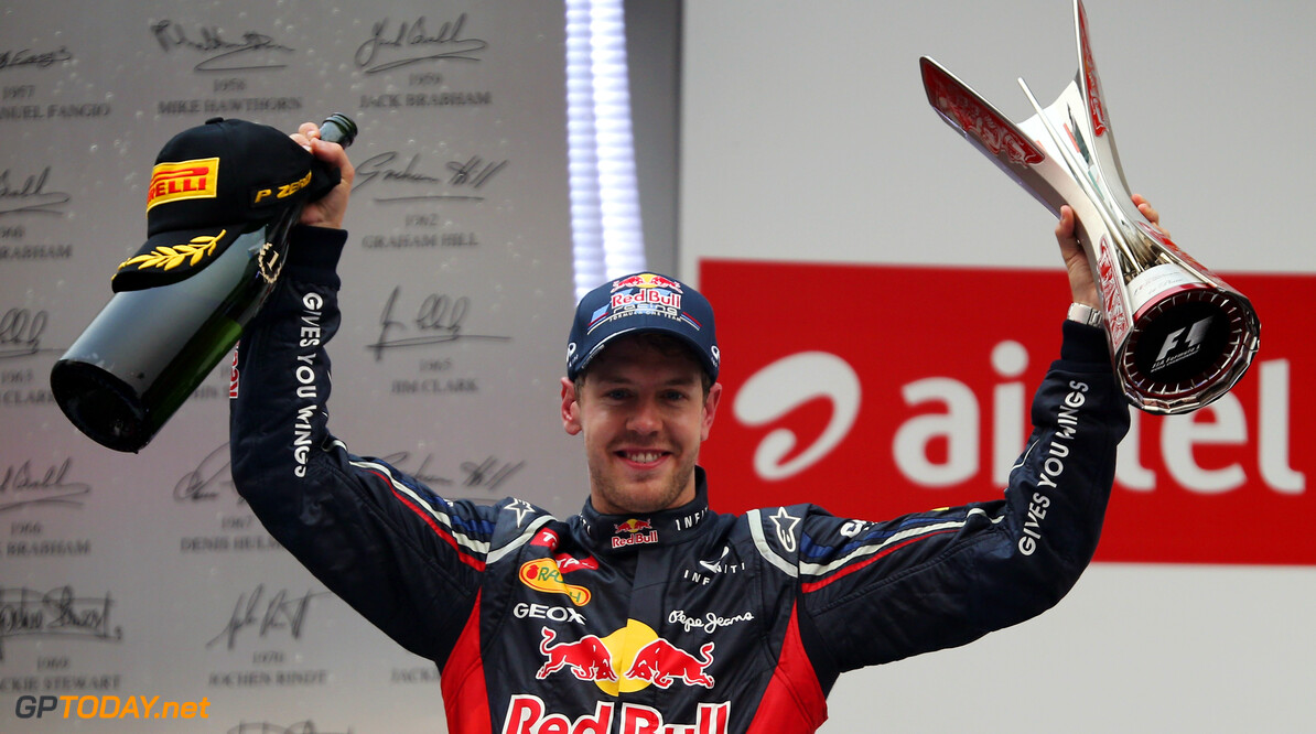 141020671KR00119_F1_Grand_P NOIDA, INDIA - OCTOBER 28:  Sebastian Vettel of Germany and Red Bull Racing celebrates on the podium after winning the Indian Formula One Grand Prix at Buddh International Circuit on October 28, 2012 in Noida, India.  (Photo by Mark Thompson/Getty Images) *** Local Caption *** Sebastian Vettel F1 Grand Prix Of India Mark Thompson Noida India  Formula One Racing