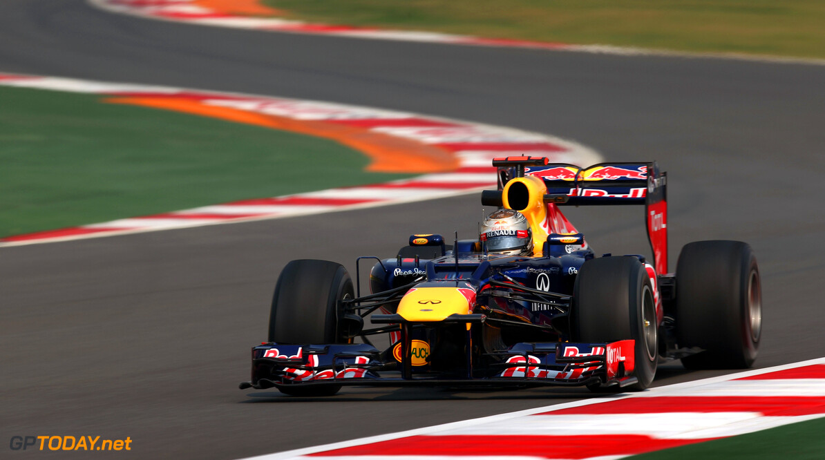 141020623KR00038_F1_Grand_P NOIDA, INDIA - OCTOBER 26:  Sebastian Vettel of Germany and Red Bull Racing drives during practice for the Indian Formula One Grand Prix at Buddh International Circuit on October 26, 2012 in Noida, India.  (Photo by Clive Mason/Getty Images) *** Local Caption *** Sebastian Vettel F1 Grand Prix Of India - Practice Clive Mason Noida India  Formula One Racing