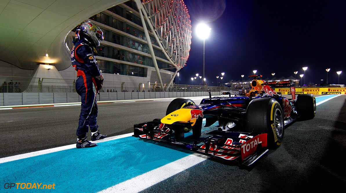 141020749VR023_F1_Grand_Pri ABU DHABI, UNITED ARAB EMIRATES - NOVEMBER 03:  Sebastian Vettel of Germany and Red Bull Racing stands next to his car on the track after qualifying for the Abu Dhabi Formula One Grand Prix at the Yas Marina Circuit on November 3, 2012 in Abu Dhabi, United Arab Emirates.  (Photo by Vladimir Rys/Getty Images) *** Local Caption *** Sebastian Vettel F1 Grand Prix of Abu Dhabi - Qualifying Vladimir Rys Abu Dhabi United Arab Emirates  Formula One Racing