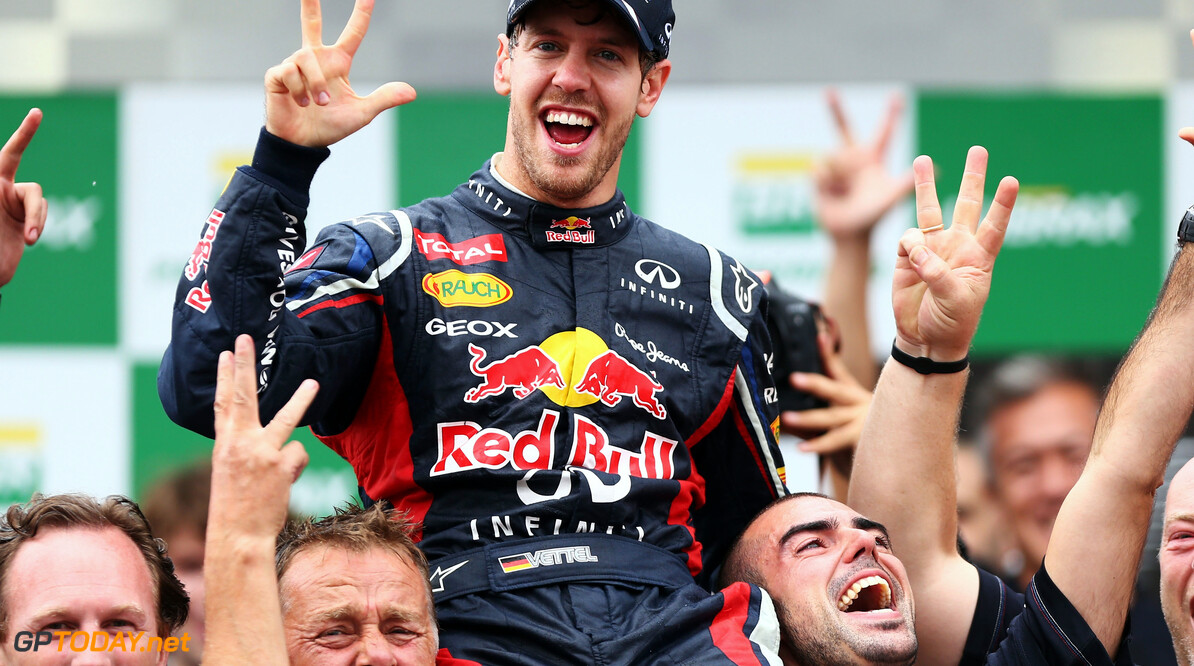 141020825KR00137_F1_Grand_P SAO PAULO, BRAZIL - NOVEMBER 25:  Sebastian Vettel of Germany and Red Bull Racing celebrates with team mates on the podium as he finishes in sixth position and clinches his third consecutive drivers world championship during the Brazilian Formula One Grand Prix at the Autodromo Jose Carlos Pace on November 25, 2012 in Sao Paulo, Brazil.  (Photo by Paul Gilham/Getty Images) *** Local Caption *** Sebastian Vettel F1 Grand Prix of Brazil Paul Gilham Sao Paulo Brazil  Formula One Racing Interlagos