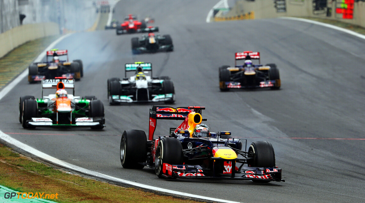 141020825KR00293_F1_Grand_P SAO PAULO, BRAZIL - NOVEMBER 25:  Sebastian Vettel of Germany and Red Bull Racing leads a train of cars through turn one during the Brazilian Formula One Grand Prix at the Autodromo Jose Carlos Pace on November 25, 2012 in Sao Paulo, Brazil.  (Photo by Mark Thompson/Getty Images) *** Local Caption *** Sebastian Vettel F1 Grand Prix of Brazil Mark Thompson Sao Paulo Brazil  Formula One Racing Interlagos