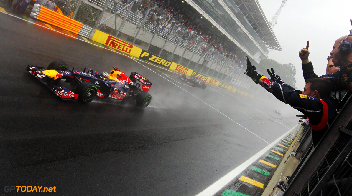 141020825KR00123_F1_Grand_P SAO PAULO, BRAZIL - NOVEMBER 25:  Team mates celebrate as Sebastian Vettel of Germany and Red Bull Racing crosses the line to finish in sixth position and clinch the drivers world championship during the Brazilian Formula One Grand Prix at the Autodromo Jose Carlos Pace on November 25, 2012 in Sao Paulo, Brazil.  (Photo by Ker Robertson/Getty Images) *** Local Caption *** Sebastian Vettel F1 Grand Prix of Brazil Ker Robertson Sao Paulo Brazil  Formula One Racing Interlagos