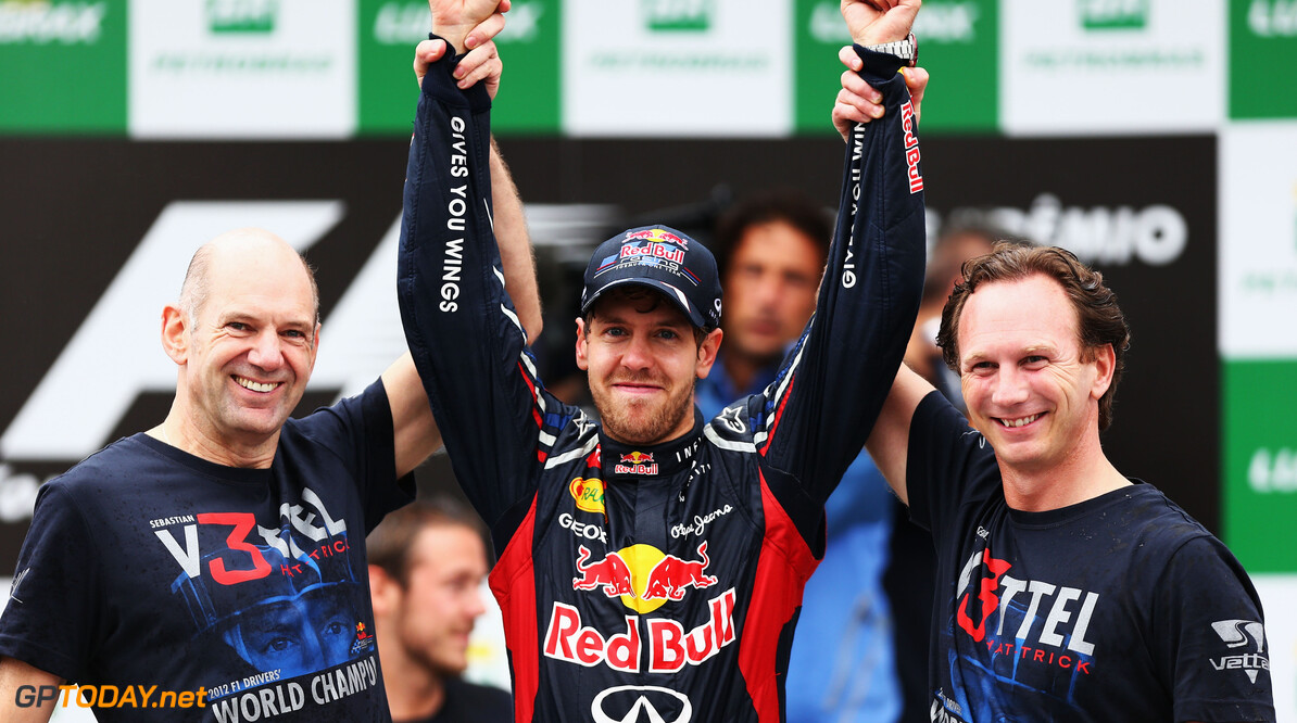 141020825KR00144_F1_Grand_P SAO PAULO, BRAZIL - NOVEMBER 25:  Sebastian Vettel (C) of Germany and Red Bull Racing celebrates with Red Bull Racing Chief Technical Officer Adrian Newey (L) and Team Principal Christian Horner (R) on the podium as he finishes in sixth position and clinches his third consecutive drivers world championship during the Brazilian Formula One Grand Prix at the Autodromo Jose Carlos Pace on November 25, 2012 in Sao Paulo, Brazil.  (Photo by Paul Gilham/Getty Images) *** Local Caption *** Sebastian Vettel F1 Grand Prix of Brazil Paul Gilham Sao Paulo Brazil  Formula One Racing Interlagos