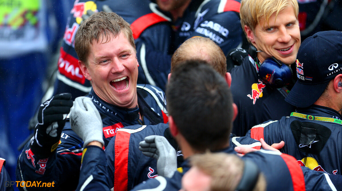 141020825KR00246_F1_Grand_P SAO PAULO, BRAZIL - NOVEMBER 25:  Red Bull Racing mechanics celebrate as Sebastian Vettel of Germany and Red Bull Racing finishes in sixth position and clinches his third consecutive drivers world championship during the Brazilian Formula One Grand Prix at the Autodromo Jose Carlos Pace on November 25, 2012 in Sao Paulo, Brazil.  (Photo by Clive Mason/Getty Images) F1 Grand Prix of Brazil Clive Mason Sao Paulo Brazil  Formula One Racing Interlagos