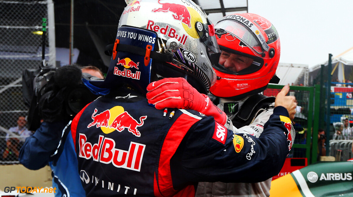 141020825KR00101_F1_Grand_P SAO PAULO, BRAZIL - NOVEMBER 25:  Sebastian Vettel of Germany and Red Bull Racing is congratulated by Michael Schumacher of Germany and Mercedes GP in parc ferme as he finishes in sixth position and clinches the drivers world championship during the Brazilian Formula One Grand Prix at the Autodromo Jose Carlos Pace on November 25, 2012 in Sao Paulo, Brazil.  (Photo by Mark Thompson/Getty Images) *** Local Caption *** Sebastian Vettel; Michael Schumacher F1 Grand Prix of Brazil Mark Thompson Sao Paulo Brazil  Formula One Racing Interlagos