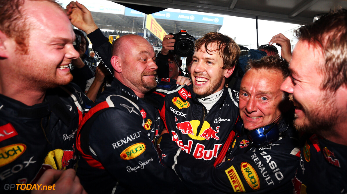 141020825KR00140_F1_Grand_P SAO PAULO, BRAZIL - NOVEMBER 25:  Sebastian Vettel of Germany and Red Bull Racing celebrates with team mates in his garage as he clinches the drivers world championship during the Brazilian Formula One Grand Prix at the Autodromo Jose Carlos Pace on November 25, 2012 in Sao Paulo, Brazil.  (Photo by Paul Gilham/Getty Images) *** Local Caption *** Sebastian Vettel F1 Grand Prix of Brazil Paul Gilham Sao Paulo Brazil  Formula One Racing Interlagos