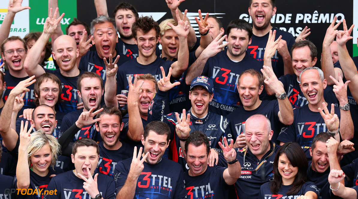 141020825KR00184_F1_Grand_P SAO PAULO, BRAZIL - NOVEMBER 25:  Sebastian Vettel of Germany and Red Bull Racing celebrates with team mates on the podium as he finishes in sixth position and clinches his third consecutive drivers world championship during the Brazilian Formula One Grand Prix at the Autodromo Jose Carlos Pace on November 25, 2012 in Sao Paulo, Brazil.  (Photo by Clive Mason/Getty Images) *** Local Caption *** Sebastian Vettel F1 Grand Prix of Brazil Clive Mason Sao Paulo Brazil  Formula One Racing Interlagos