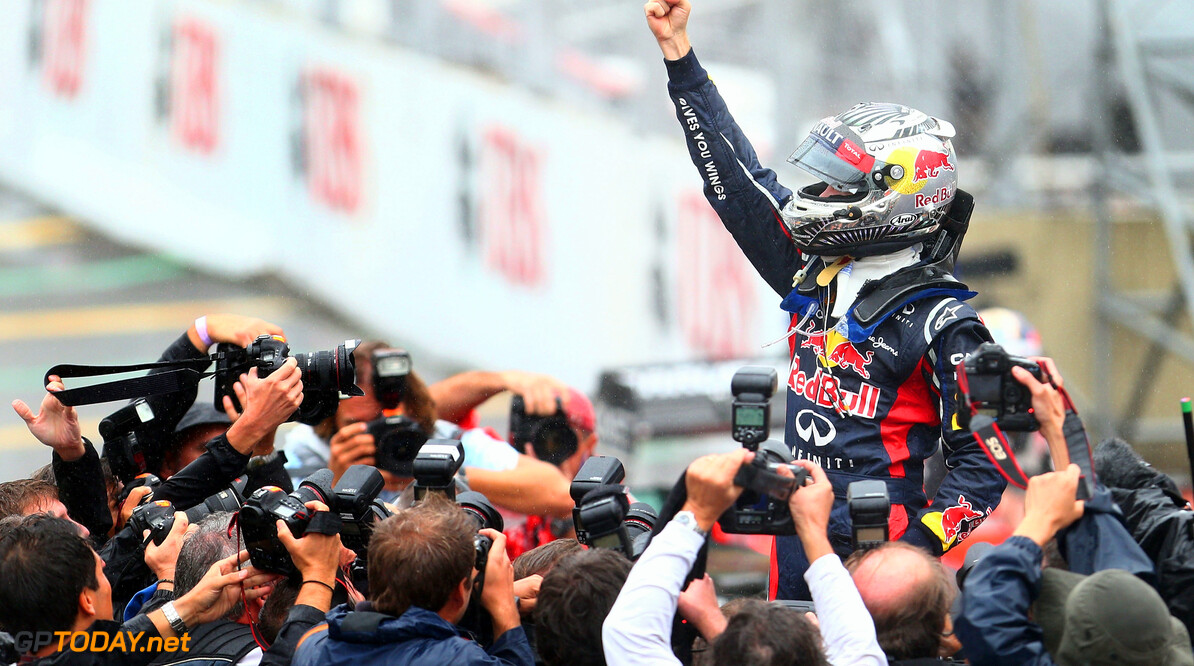 141020825KR00176_F1_Grand_P SAO PAULO, BRAZIL - NOVEMBER 25:  Sebastian Vettel of Germany and Red Bull Racing celebrates in parc ferme as he finishes in sixth position and clinches the drivers world championship during the Brazilian Formula One Grand Prix at the Autodromo Jose Carlos Pace on November 25, 2012 in Sao Paulo, Brazil.  (Photo by Clive Mason/Getty Images) *** Local Caption *** Sebastian Vettel F1 Grand Prix of Brazil Clive Mason Sao Paulo Brazil  Formula One Racing Interlagos