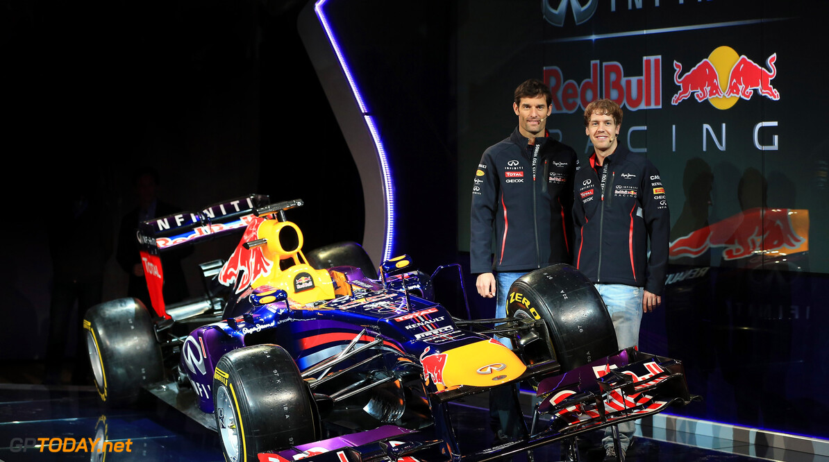160437438RH00003_Infiniti_R MILTON KEYENES, ENGLAND - FEBRUARY 03:  Drivers Mark Webber of Australia (L) and Sebastian Vettel of Germany pose along side the new car during the Infiniti Red Bull Racing RB9 launch on February 3, 2013 in Milton Keyenes, England.  (Photo by Richard Heathcote/Getty Images) Infiniti Red Bull Racing RB9 Launch Richard Heathcote Milton Keyenes United Kingdom  Formula One Racing
