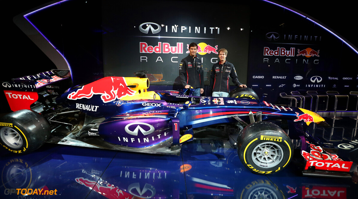 160437438RH00002_Infiniti_R MILTON KEYENES, ENGLAND - FEBRUARY 03:  Drivers Mark Webber of Australia (L) and Sebastian Vettel of Germany pose along side the new car during the Infiniti Red Bull Racing RB9 launch on February 3, 2013 in Milton Keyenes, England.  (Photo by Mark Thompson/Getty Images) Infiniti Red Bull Racing RB9 Launch Mark Thompson Milton Keyenes United Kingdom  Formula One Racing