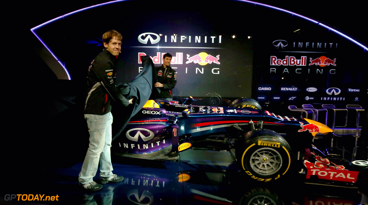 160437438RH00004_Infiniti_R MILTON KEYENES, ENGLAND - FEBRUARY 03:  Drivers Mark Webber of Australia and Sebastian Vettel of Germany reveal the new car during the Infiniti Red Bull Racing RB9 launch on February 3, 2013 in Milton Keyenes, England.  (Photo by Mark Thompson/Getty Images) Infiniti Red Bull Racing RB9 Launch Mark Thompson Milton Keyenes United Kingdom  Formula One Racing
